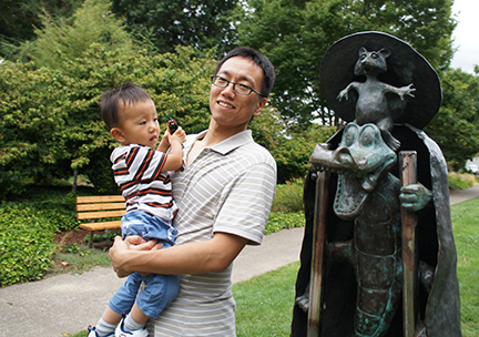 Jinsub is at Corvallis Central Park with his son.