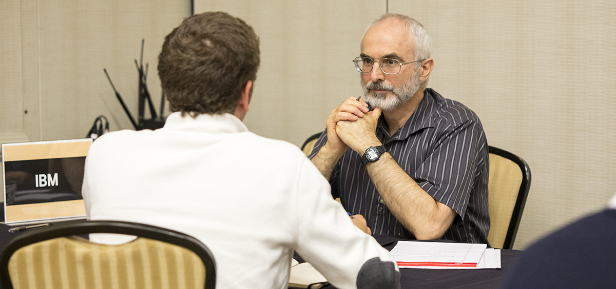 Photo of Paul McKenney talking to a student