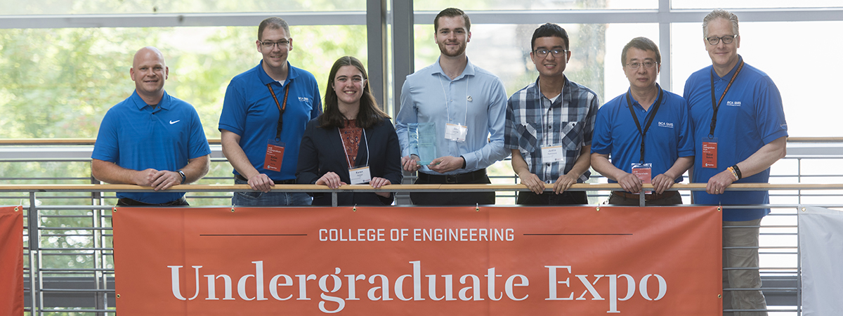 Photo of students and industry representatives and Expo.