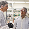 Photo of two men in a cleanroom