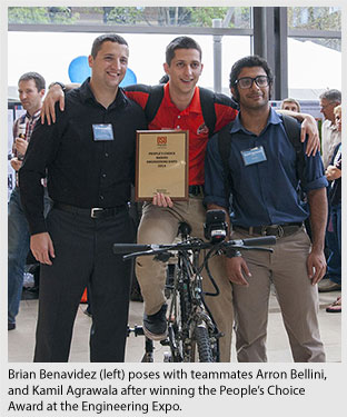 Brian Benavidez (left) poses with teammates Arron Bellini, and Kamil Agrawala after winning the People's Choice  Award at the Engineering Expo.