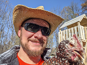 Eric Ianni with a chicken