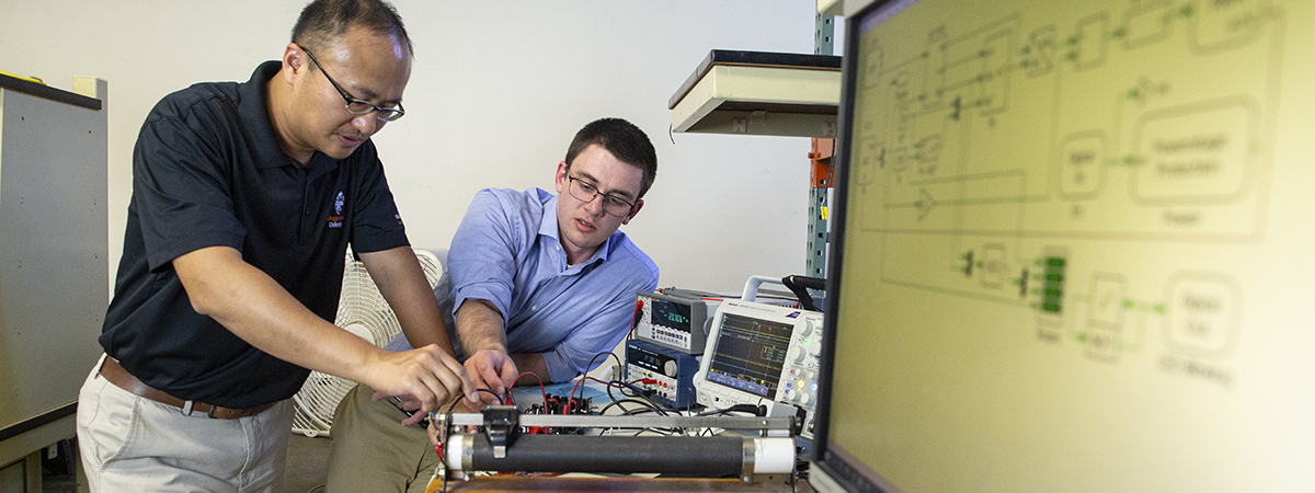Photo of professor and student in a lab