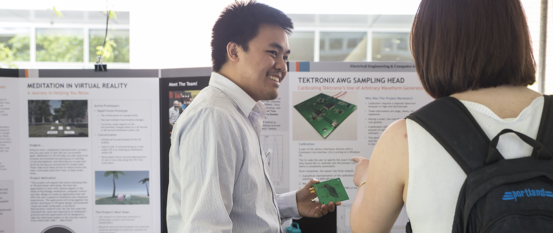 Student explains his senior design project at Expo