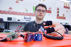 Photo of a student with sensors on his fingers
