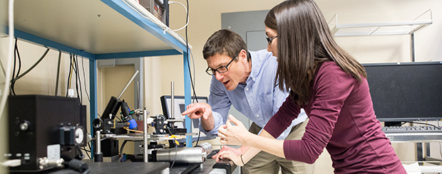 Photo of professor John Conley with a graduate student in a lab
