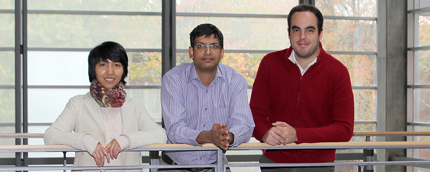 Three EECS faculty members