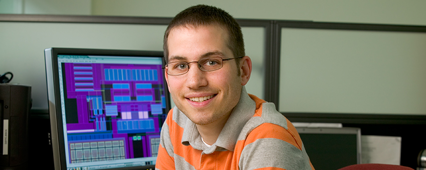 Photo of graduate student in his office