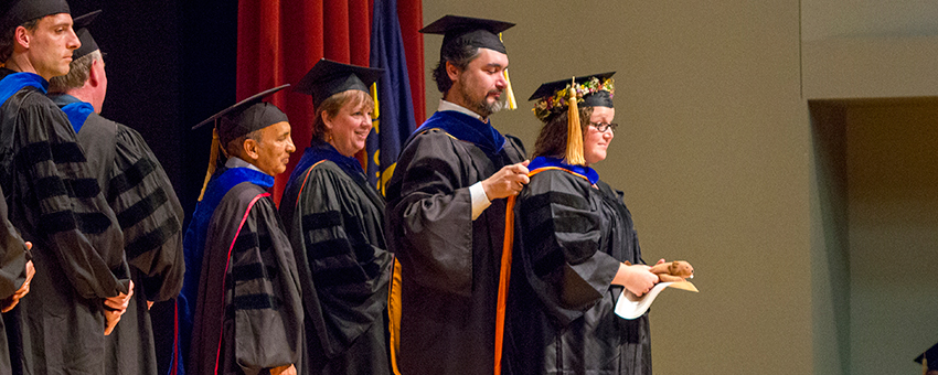 Photo of professor hooding a graduate student at the graduation ceremony