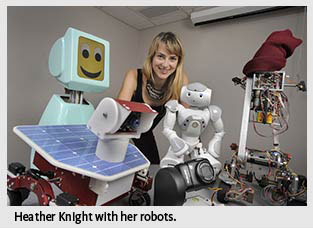 Photo of Heather Knight with robots.