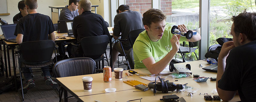 Two groups working at Oregon State's first hardware weekend (HWeekend).