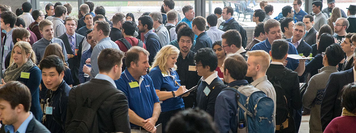 Photo of industry representatives and students talking