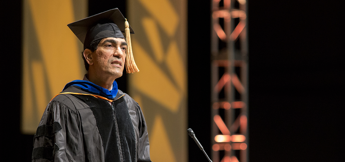 Photo of Ron Khormaei giving his speech at the EECS graduation celebration.