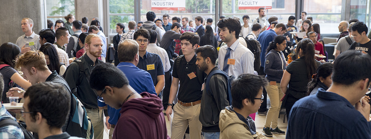 Crowd of people interacting at networking event
