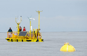 The Ocean Sentinel, just deployed, with the buoy in the foreground.