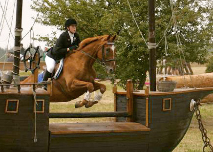 Cera Olsen rides her horse during an event.