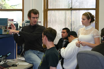 Instructor Matt Shuman and peer leader, Carissa Pocock, help students in class