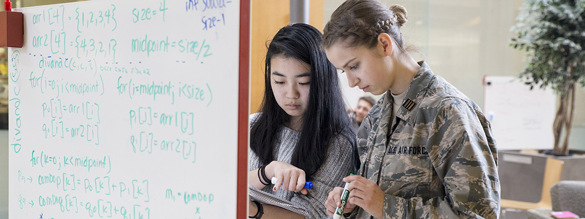 Photo of two female students studying