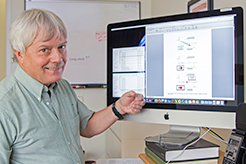 Photo of John Wager with Apple monitor