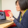 Photo of Yue Zhang with a computer