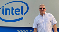 Photo of Vaughan Schmidt in front of an Intel sign